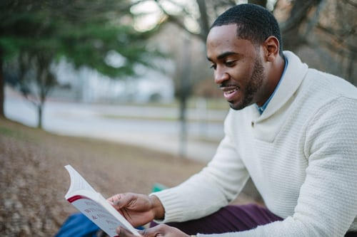 adult student reading a book